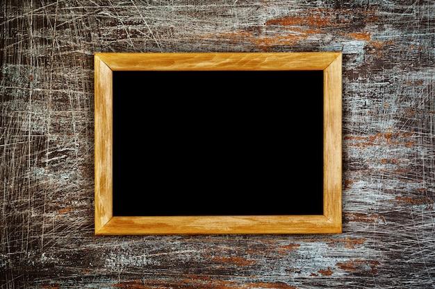 Grunge background with wooden frame Premium Photo