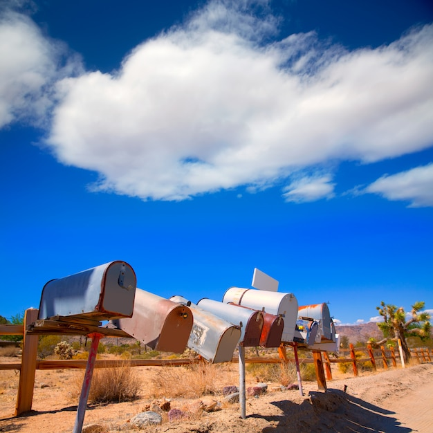 Grunge mail boxes in a row at california mohave desert Premium Photo
