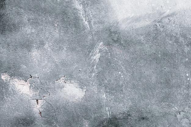 Серая бетонная стена, серая городская предпосылка, текстура старого grunge monochrome, обои. Premium Фотографии