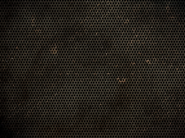 Grunge perforated metallic texture background Free Photo