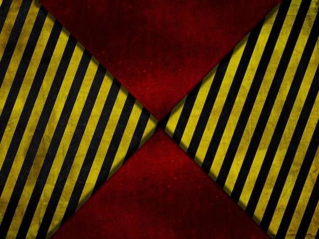 グランジスタイルの赤い金属の背景に黄色と黒の警告ストライプ 無料写真