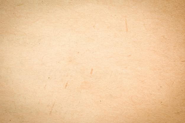 Старая грубая текстура предпосылки grunge бежевой бумаги для дизайна Premium Фотографии