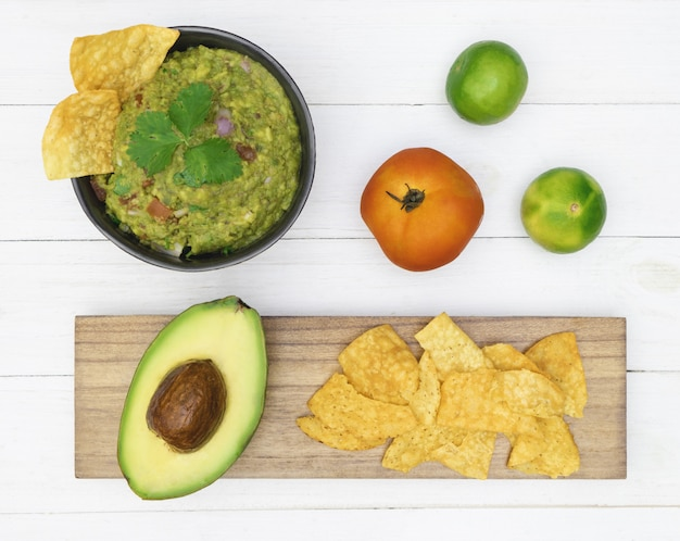 Guacamole avocado with chips mexican food flat lay top view Premium Photo