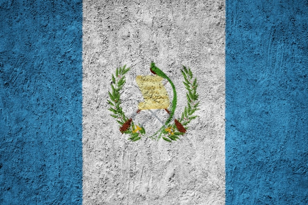 Guatemala flag painted on grunge wall Premium Photo