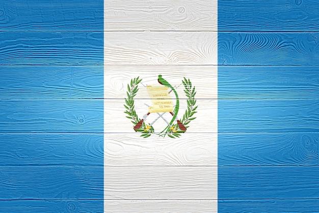 Guatemala flag painted on wooden planks Premium Photo