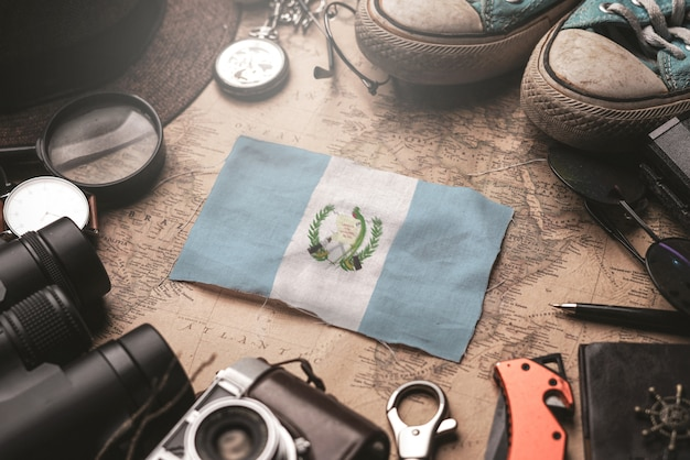 Guatemala flag between traveler's accessories on old vintage map. tourist destination concept. Premium Photo