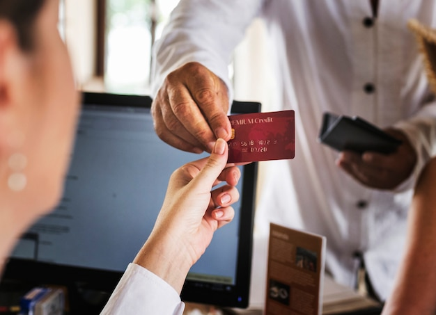 Guests checking in to a hotel Premium Photo