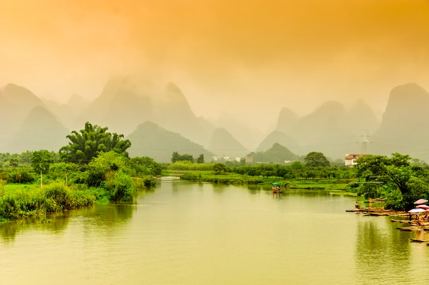 Guilin yangshuo beautiful scenery of mountains and rivers photo guilin yangshuo beautiful scenery of mountains and rivers premium photo voltagebd Images