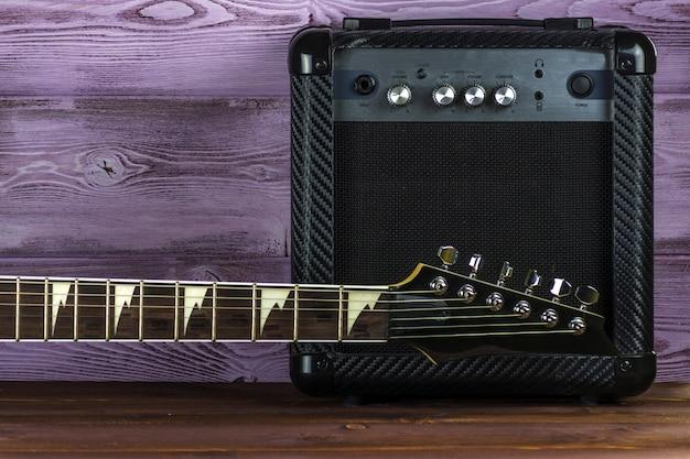 Guitar amplifier and electric guitar Premium Photo