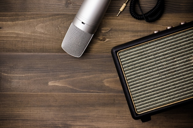 Guitar amplifier and microphone on wooden background. vintage effect style. Premium Photo