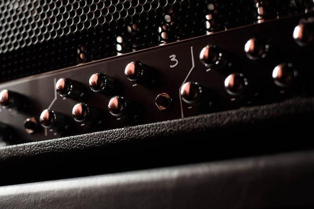 A guitar combo amplifier or speaker closeup on black Premium Photo