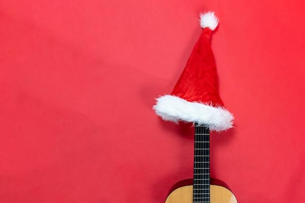 Guitar wearing a santa claus hat Premium Photo
