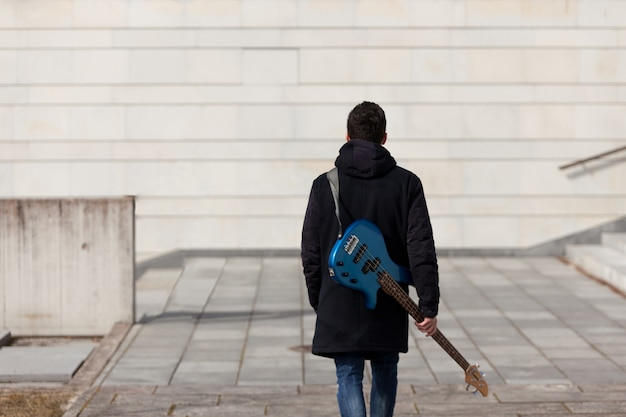 Guitarist back view Free Photo