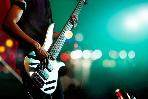 Guitarist bass on stage for background Premium Photo