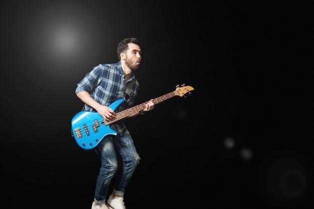 Guitarist on stage Free Photo