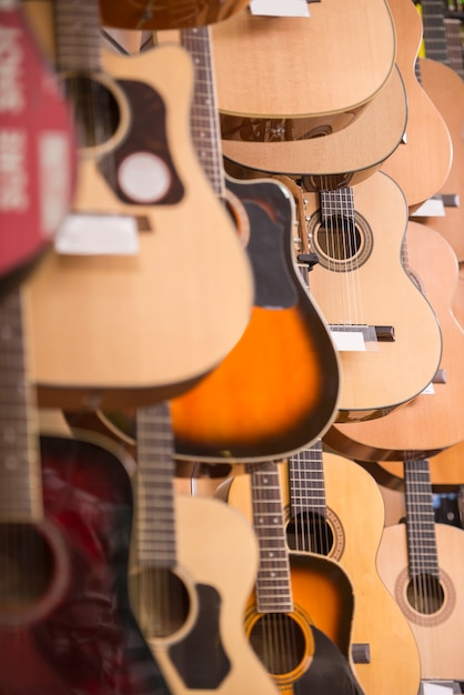 Guitars is hanging on wall of music studio. Premium Photo