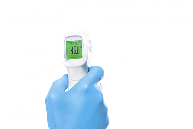 Gun electronic medical thermometer measuring shows the result 36.6 celsius Premium Photo