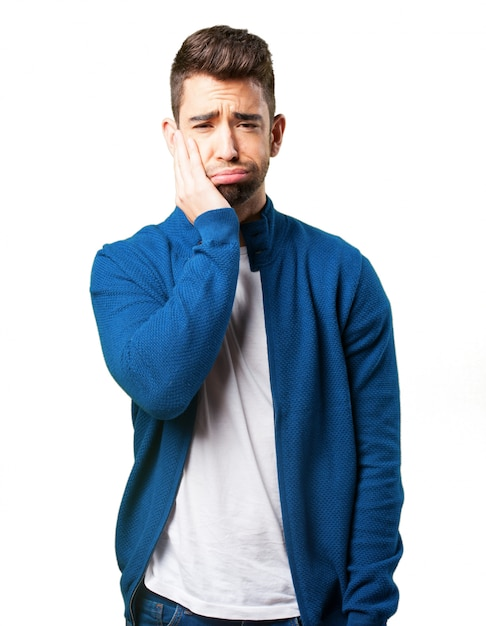 Guy in a blue jacket with toothache Free Photo