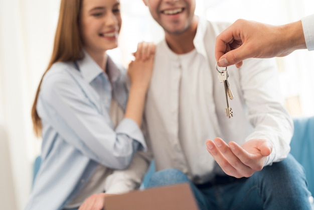 Guy and girl make a contract with realtor buying property. Premium Photo