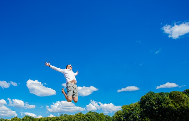 Guy is hovering in the air. the guy is hovering in the air against the background of a fountain Premium Photo