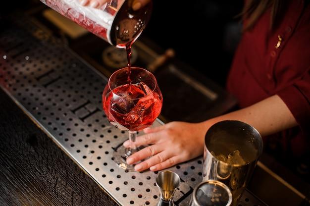 Guy making a campari cocktail on the bar Premium Photo