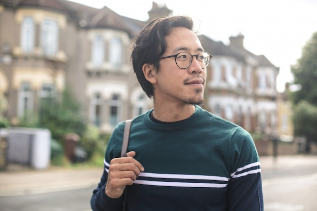 Guy walking in the street, in a residential area Premium Photo