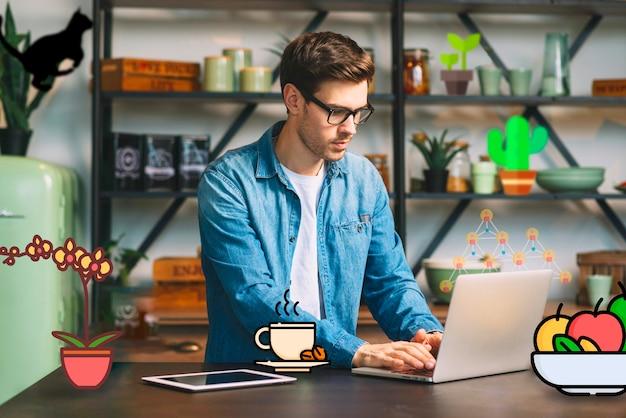 Guy working on laptop and having icons surrounding him Free Photo