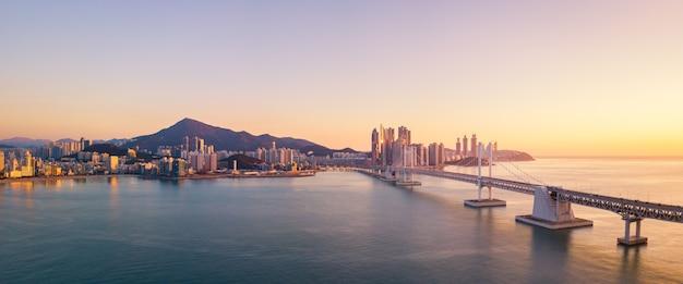 Gwangan bridge and haeundae aerial view at sunrise, busan, south korea Premium Photo