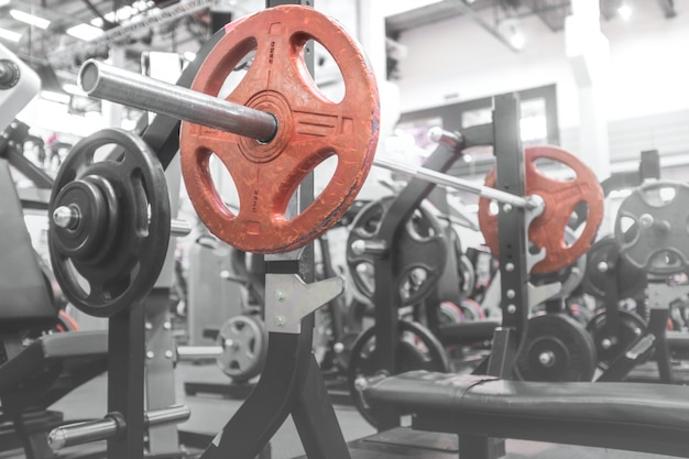 Gym barbell on the bench for the bench press Premium Photo