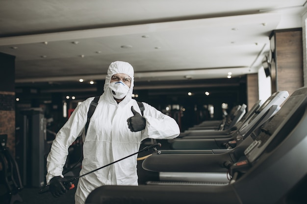Gym cleaning and disinfection Premium Photo
