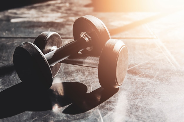 Gym equipment close up dumbbells on floor for background Premium Photo