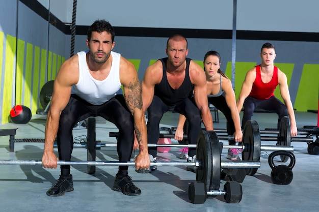 Gym group with weight lifting bar crossfit workout Premium Photo