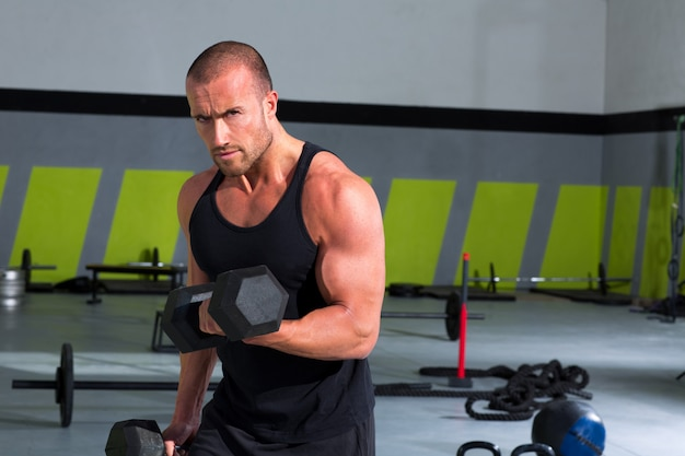 Gym man with dumbbells exercise crossfit Premium Photo