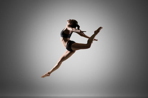 Gymnast girl jumping Free Photo