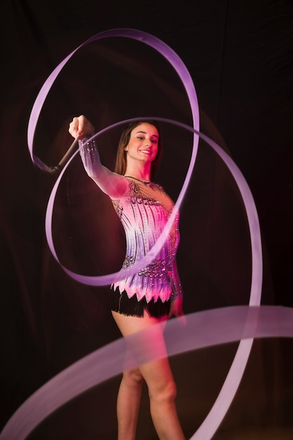 Gymnast using the ribbon Free Photo