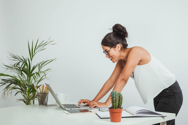 Haapy businesswoman looking at her laptop Free Photo