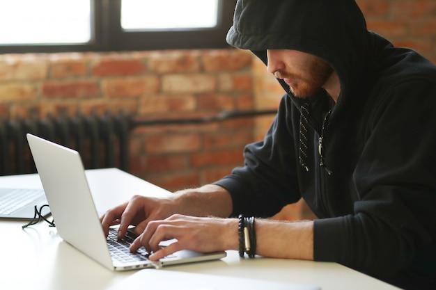 Hacker man on laptop Free Photo