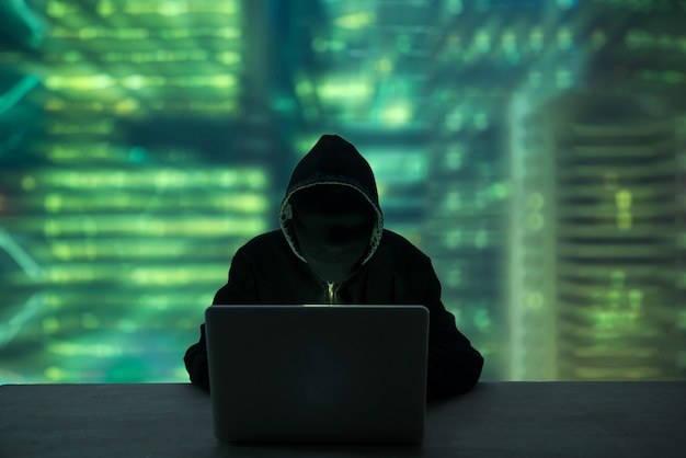 Hacker stealing password and identity, computer crime Premium Photo