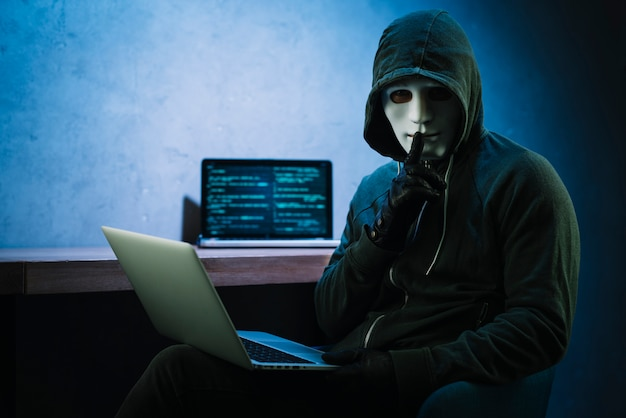 Hacker with laptop Free Photo