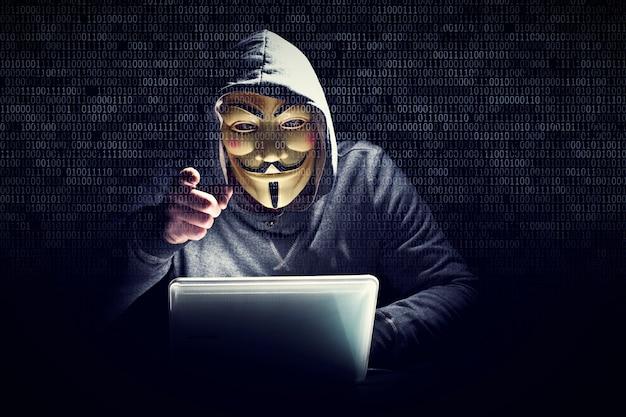 Hacker with mask Premium Photo