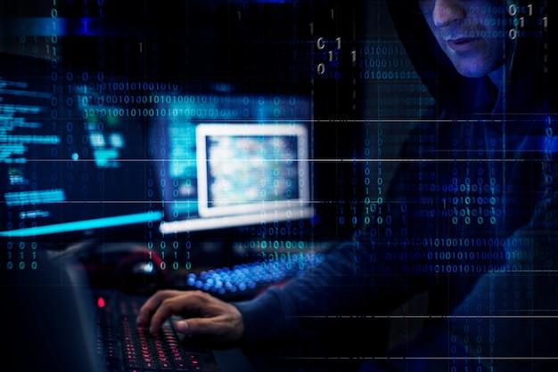 Hacker working using computer with codes Premium Photo