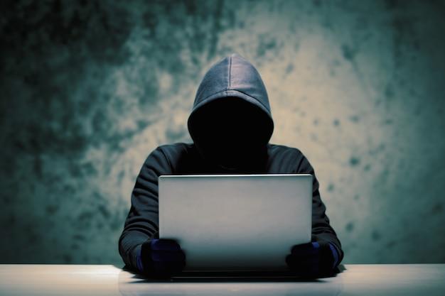 Hackers with computer data theft. Premium Photo