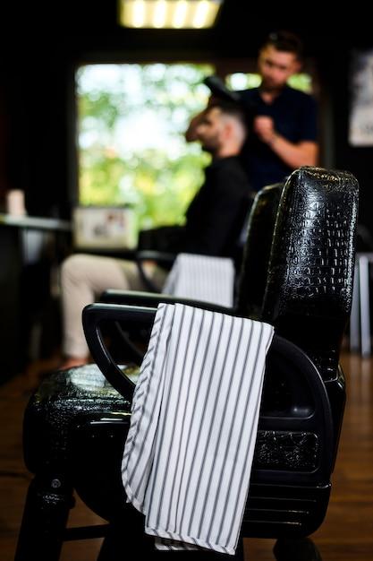 Hair salon chair with towel on armchair Free Photo