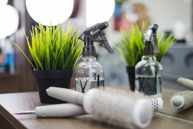 Hair salon tools with plant Free Photo