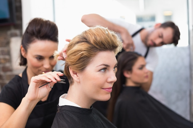 Hairdressers working on their clients Premium Photo
