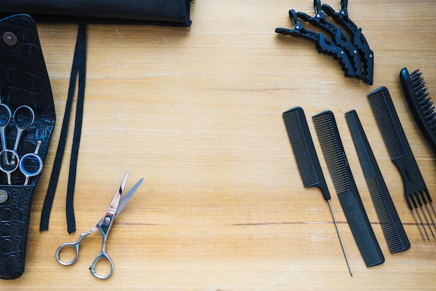 Hairdressing tools on wooden tabletop Free Photo