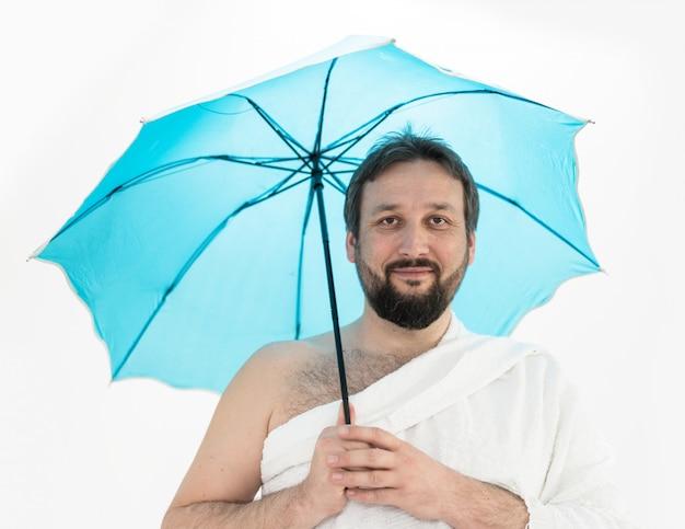 Hajj pilgrim with umbrella Premium Photo