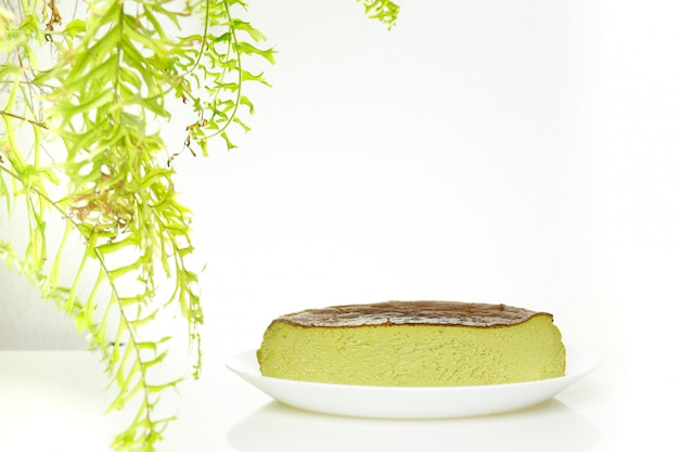Premium Photo Half Cup Of Matcha Green Tea Basque Burnt Cheesecake Isolated On White Background
