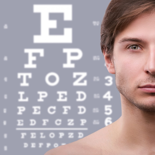 Half of male face and eye chart Premium Photo