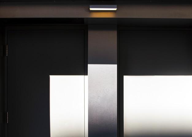 Half-open black and white doors Free Photo